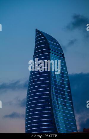 Azerbaijan, Baku, View of one of the three Flame Towers at dusk - Stock Photo