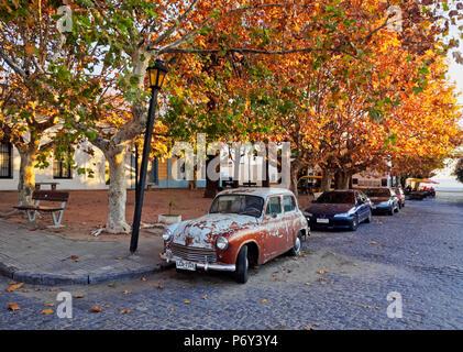 Uruguay, Colonia Department, Colonia del Sacramento, Vintage car on the cobblestone lane of the historic quarter. - Stock Photo