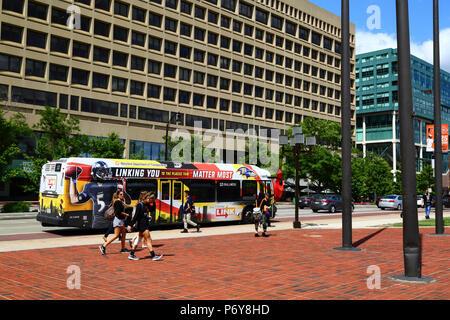 Baltimore Link public bus on East Pratt Street near Inner Harbor, Baltimore, Maryland, USA - Stock Photo