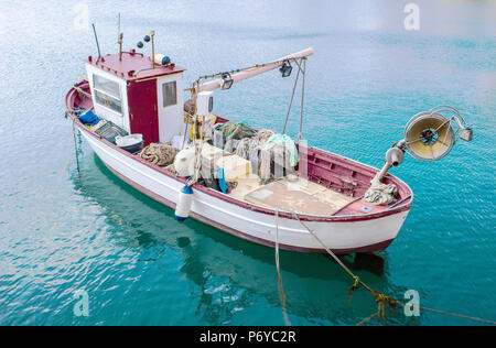 fishing boat on the water / A photo of Fishing boat on the ocean  /  small fishing boats on the ocean - Stock Photo