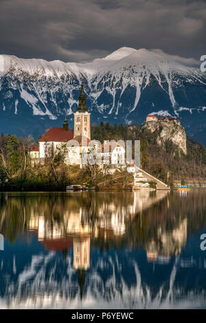Afternoon sunlight over Church of the Assumption of Mary, Lake Bled, Upper Carniola, Slovenia - Stock Photo