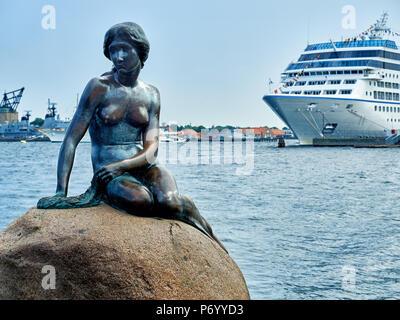 Famous Little Mermaid Statue in Copenhagen Denmark - Stock Photo