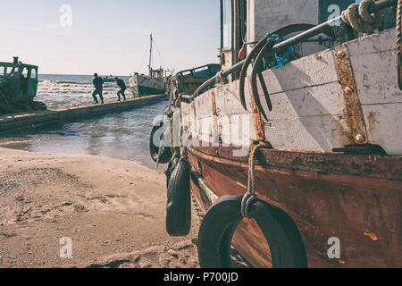 Old motorized fishing vessels are preparing to leave for the Baltic Sea for summer fishing - Stock Photo