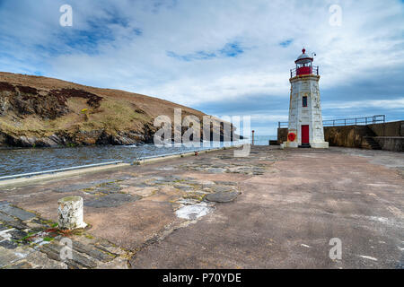The lighthouse on the harbour at Lybster in Caithness on the east coast of Scotland - Stock Photo