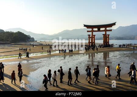 The red wooden torii gate at low tide on Miyajima island, Itsukushima, UNESCO World Heritage Site, Hiroshima Prefecture, Honshu, Japan, Asia - Stock Photo