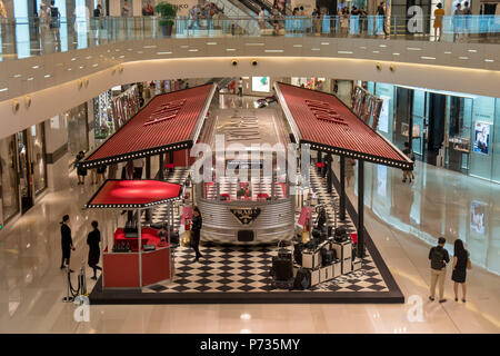Shanghai, Shanghai, China. 4th July, 2018. Shanghai, CHINA- The silver 'Prada Train' can be seen at a shopping mall in Shanghai, China. The silver 'train' is a pop-up store of Prada. Credit: SIPA Asia/ZUMA Wire/Alamy Live News - Stock Photo