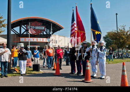 Sailors and Marines from Joint Expeditionary Base Little Creek-Fort Story, right, present colors while Marine Corps Gunnery Sgt. Angela Mink, left before the 12th Annual Fleet Ride at the Bayside Harley-Davidson in Portsmouth, Va. All proceeds from the event go to the Navy Marine Corps Relief Society. ( - Stock Photo