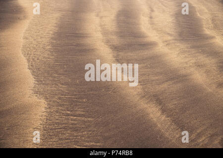 Line Pattern in the mixture of yellow and black sand close up, Costa Adeje, Tenerife, Canary Islands, Spain - Stock Photo