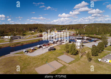 Javre, Sweden - June 21, 2018: Aerial view of Javre harbour, light house and the higway E4. - Stock Photo