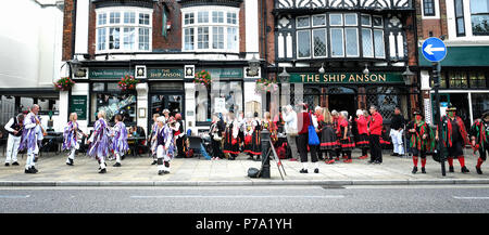 Portsmouth, UK - 15th July 2017: Morris Men dance on the streets of Portsmouth during the Day of Dance festival. - Stock Photo