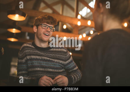 Couple talking to each other at the counter - Stock Photo