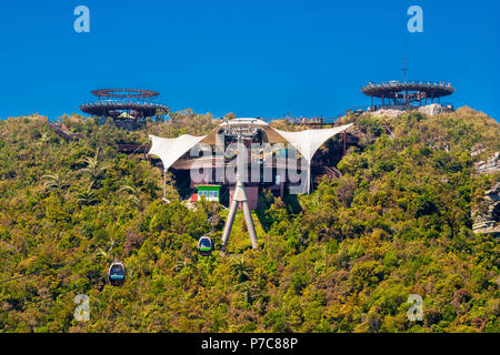 Great scene of the top station and its two circular viewing platforms of the Langkawi Cable Car, also known as  SkyCab, on the top of... - Stock Photo