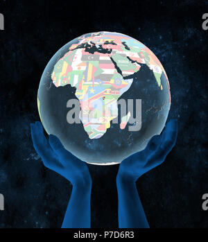 Burundi on translucent political globe in hands in space. 3D illustration. - Stock Photo