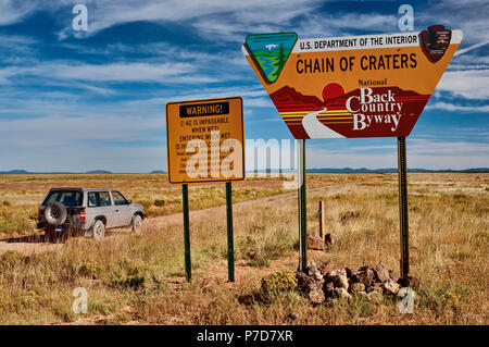 Warning signs at Chain of Craters Road at El Malpais National Monument, New Mexico, USA - Stock Photo