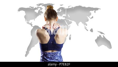 Athletic fit woman holding back with world map - Stock Photo