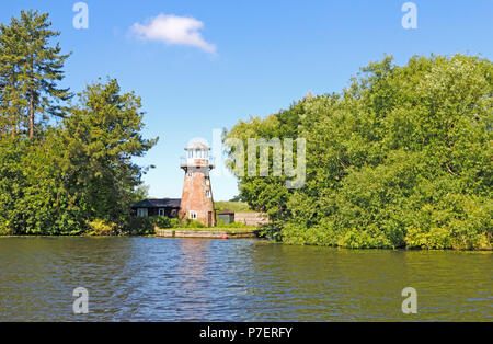 A scene on the River Bure on the Norfolk Broads featuring Dydall's Drainage Mill at Hoveton St John, Norfolk, England, United Kingdom, Europe. - Stock Photo