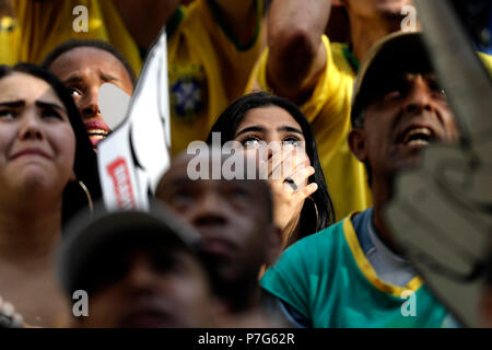 Sao Paulo, Brazil. 06th July, 2018. Brazilian fans react during the public viewing of the FIFA 2018 World Cup quarter final match between Brazil and Belgium in Sao Paulo, Brazil, 06 July 2018. Credit: Marcelo Chello/EFE/Alamy Live News - Stock Photo