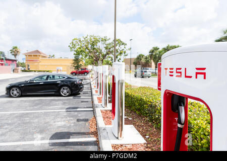 Homestead, USA - May 2, 2018: Closeup of Tesla Super Charging station in shopping mall with nobody, electric car parked at parking lot - Stock Photo