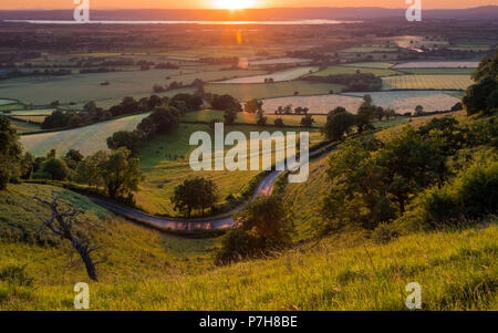 Sunset view from Coaley Peak, near Stroud looking across the Severn Vale - Stock Photo