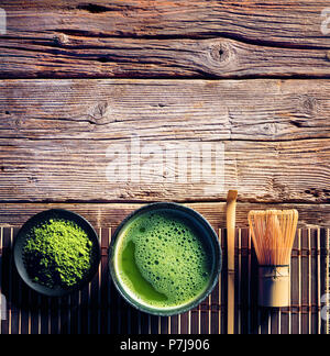 Matcha Tea In A Bowl And Bamboo Whisk And Green Powder - Stock Photo