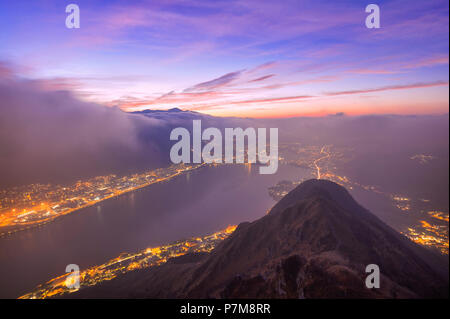 Colored clouds and fog during twilight on the Garlate Lake from Monte Barro, Monte Barro Regional Park, Brianza, Lombardy, Italy, Europe, - Stock Photo