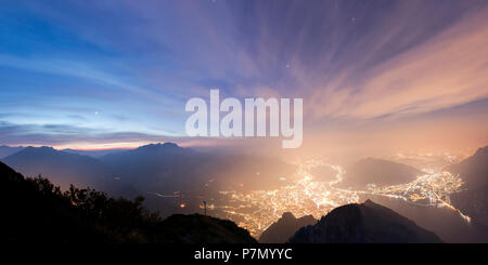 Panoramic of Lecco and Monte Resegone seen from Monte Coltignone at dawn, Lombardy, Italy - Stock Photo