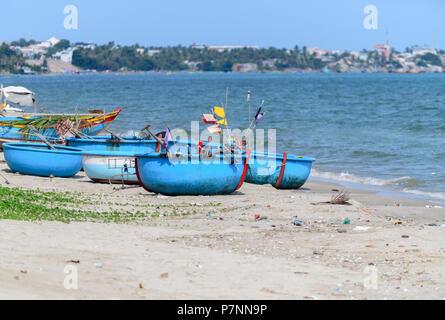 Local fishing boats on the beach in marina at Phat Thiet, Mui Ne, Vietnam - Stock Photo