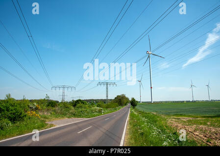 Highway, power transmission lines and wind energy plants seen in Germany - Stock Photo