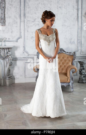 Wedding dress in Paris. Bride in a luxury apartment in a wedding dress. - Stock Photo