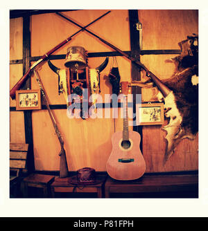 Guitar in home of the Cowboy with many decorative home - Stock Photo