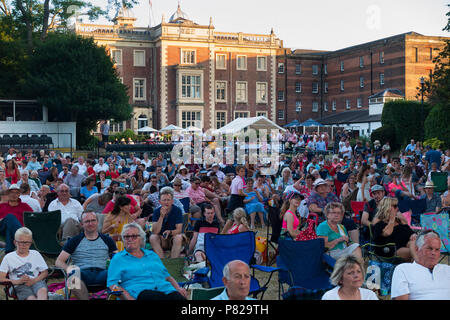 Audience at live summer music concert at the rear / back of Kneller Hall, Twickenham. It houses the Royal Military School of Music. Twickenham. (99) - Stock Photo