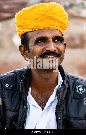 JODHPUR - RAJASTHAN - INDIA - 12 DECEMBER 2017. Portrait of a smiling handsome rajasthani man with moustache and a yellow traditional turban. Jodhpur, - Stock Photo