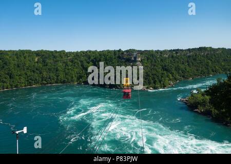 Aero car at the Whirpool Aero Car attraction passing over the roaring whirlpool rapids of the Niagara River - Niagara Falls, Ontario, Canada - Stock Photo