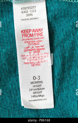 Keep away from fire label in debenhams baby's clothing - Stock Photo