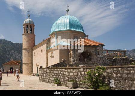 Catholic Church of Our Lady of the Rocks (Gospa od Škrpjela) with it's blue dome built on an artificial island in the Bay of Kotor, Perast, Montenegro - Stock Photo