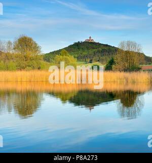 Wachsenburg castle, castle of the castle ensemble Drei Gleichen, water reflection in the lake, Mühlberg, Thuringia, Germany - Stock Photo