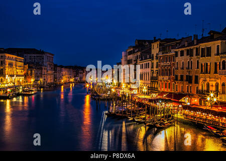 View down the Grand Canal at twilight seen from the Rialto Bridge in Venice, Italy - Stock Photo
