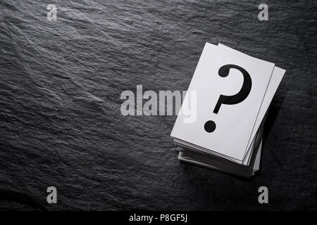 Stack of question mark cards on the stone table with copy space - Stock Photo