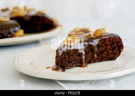 Brownie cake with salted caramel and roasted peanuts - Stock Photo