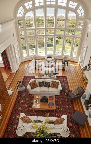 living room overlooking ocean front - Stock Photo