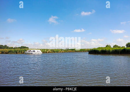 A view of the River Ant joining the River Bure on the Norfolk Broads near Horning, Norfolk, England, United Kingdom, Europe. - Stock Photo