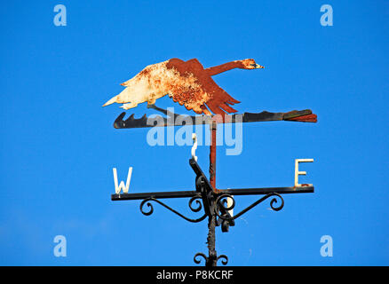 A rusting weather vane sited on the Norfolk Broads by the River Bure at Horning, Norfolk, England, United Kingdom, Europe. - Stock Photo