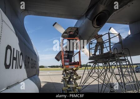 Senior Airman Tim Johnson and Senior Airman Hunter Mitchell, Aerospace Propulsion Specialist, 179th Airlift Wing Maintenance Group, evaluates an engine of the C-130H Hercules while it is running June 26, 2018, at the 179th Airlift Wing, Mansfield, Ohio, June 26, 2018. The diagnostic test requires the engine to be running for the Airman to properly identify the cause of this particular issue and is also known by aircraft mechanics as 'Man on the stand'. (U.S. Air National Guard photo by Capt. Paul Stennett/Released). () - Stock Photo