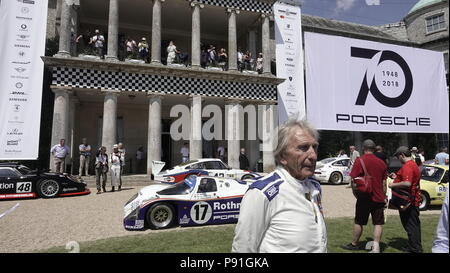 West Sussex, UK, 13th July, 2018. 13th July, 2018  Goodwood, West Sussex, U.K.  Scenes at the Goodwood Festival of Speed, Goodwood House, home of the Duke of Richmond and Gordon.  Britain's showcase of everything automobile and fast -here the various winning Porsche cars line up in honour of their 'Host' status in front of the House with Derek Bell,5 time winner of Le Mans in the iconic brand. - Stock Photo