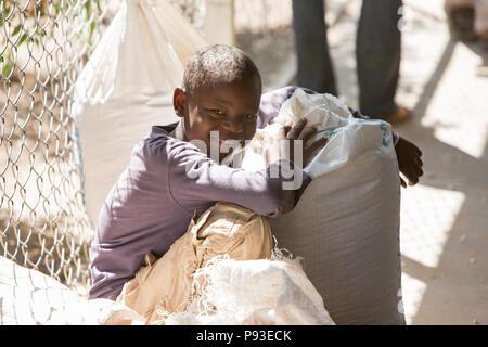 Kakuma, Kenya - Food distribution by the humanitarian aid organization World Food Program in a secure warehouse in the Kakuma refugee camp. - Stock Photo