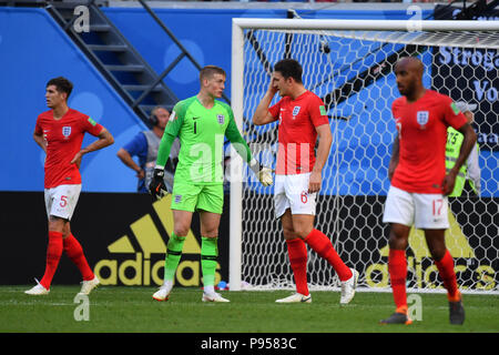 St. Petersburg, Russland. 14th July, 2018. See: John STONES (ENG), goalkeeper Jordan PICKFORD (ENG), Harry MAGUIRE (ENG), Fabian DELPH (ENG). after versustor, disappointment, frustrated, disappointed, frustrated, dejected, action. Belgium (BEL) - ENGLAND (ENG) 2-0, match 63, match for 3rd place, on 07/14/2018 in Saint Petersburg, Arena Saint Petersburg, Football World Cup 2018 in Russia from 14.06. - 15.07.2018. | usage worldwide Credit: dpa/Alamy Live News - Stock Photo