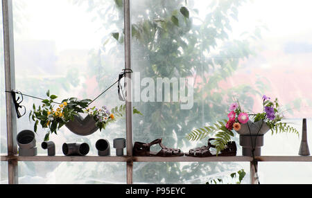 Leisure activities with recycle from waste to make flower vase to decoration home, colorful daisy in water pipe on white background - Stock Photo