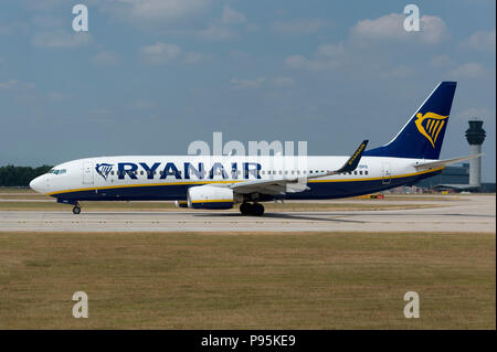 A Ryanair Boeing 737-8AS sits on the runway at Manchester Airport as it prepares to take-off. - Stock Photo