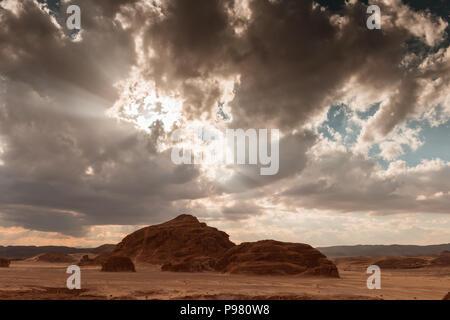 Sandy desert in Egypt at sunset - Stock Photo