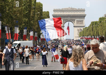 Paris, France. 16th July 2018. French people gathered along L'avenue des Champs-Élysées near the Arc de Triomphe as they awaited a parade of the winning team. Credit: Richard Milnes/Alamy Live News - Stock Photo